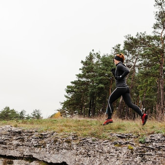 Outdoors running workout copy space