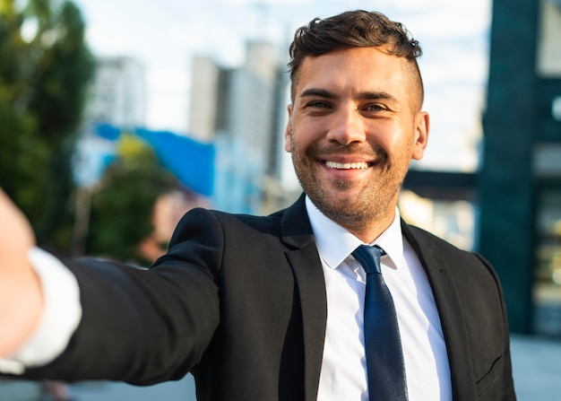 Outdoors successful business person taking a selfie