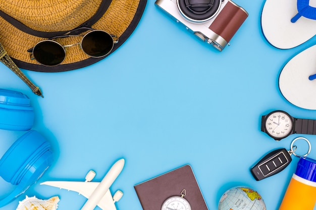 Outfit and accessories of traveler on blue background with copy space,