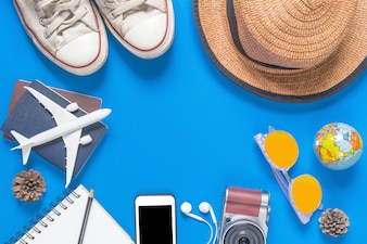 Outfit and accessories of traveler on blue background with copy space, Travel concept
