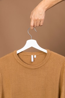Outfit with clothing tag on white hanger