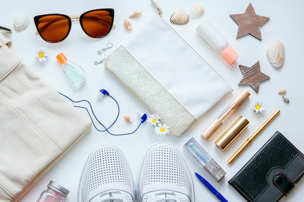 Outfit of young woman or modern teenager girl on white background – shoes, cosmetic and lifestyle accessories. flat lay objects.