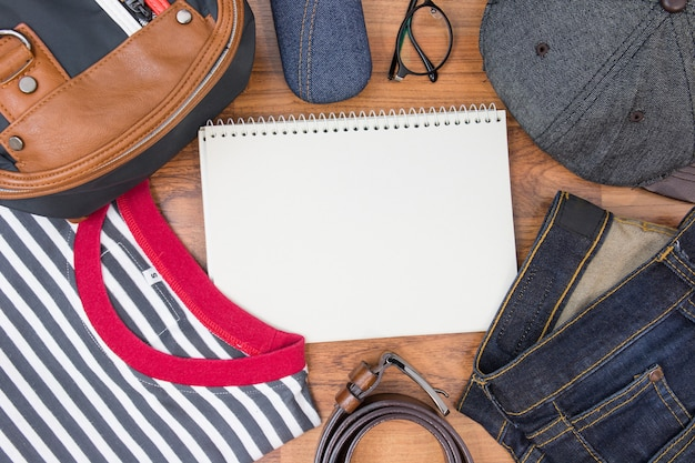 Outfits of traveler, boy, male, men's casual outfits on wood board background