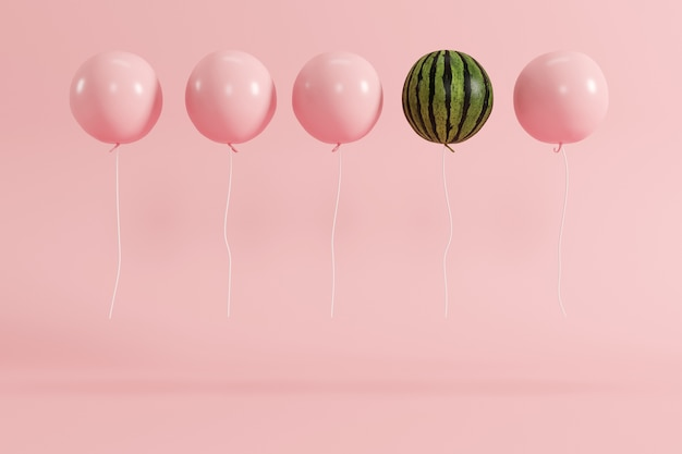 Outstanding balloon watermelon concept on pastel pink background