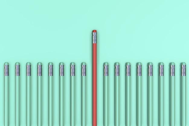 Выдающийся красный карандаш на зеленом фоне пастель. минимальная бизнес-концепция.