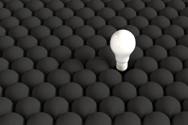 Outstanding white light bulb on floating among black light bulbs.