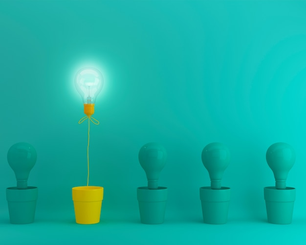 Outstanding yellow light bulbs with glowing in flowerpot one different idea on green backg