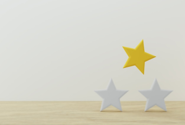 Outstanding yellow star shape on wooden table and white background