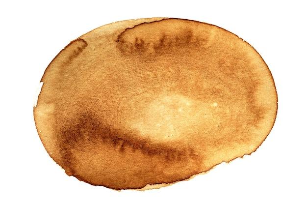 白い背景に分離された楕円形のコーヒーの染み-内線用のスペース