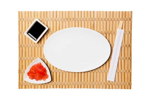 Oval white plate with chopsticks for sushi