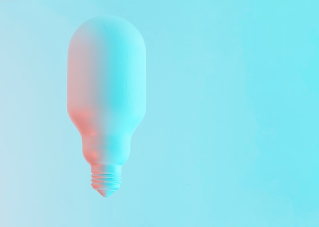 Oval white shape painted light bulb against blue background