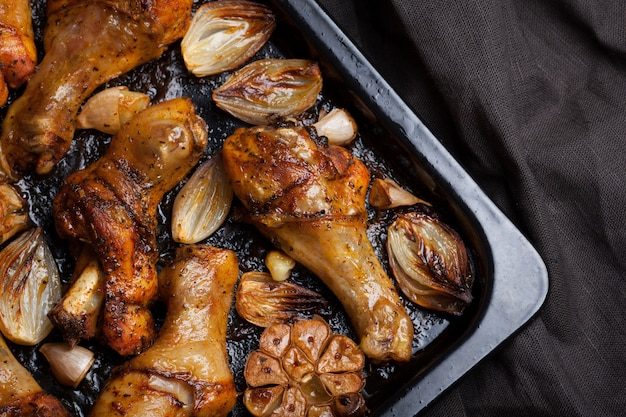 Oven baked chicken legs with onions.