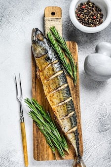 Oven baked whole mackerel fish with herbs.