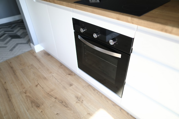 An oven is installed in kitchen furniture apartment