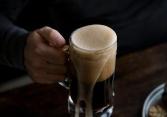 Overflowing pint of beer