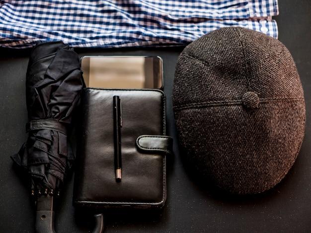 Overhead businessman working elegant man supplies on black dark table