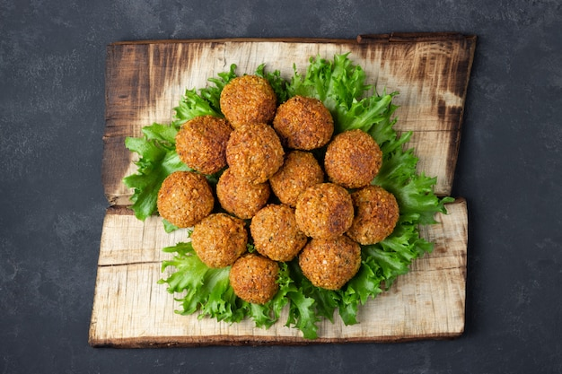 Overhead image of arabic snack falafel in the form of chickpea balls with spices. dark slate background.