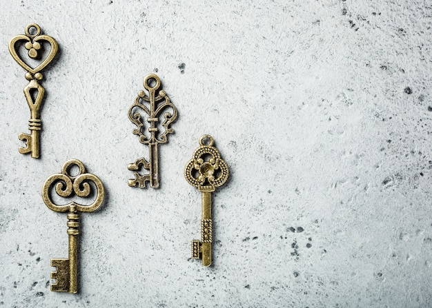 Overhead shoot of many different old keys on old gray concrete surface. concept with copy space