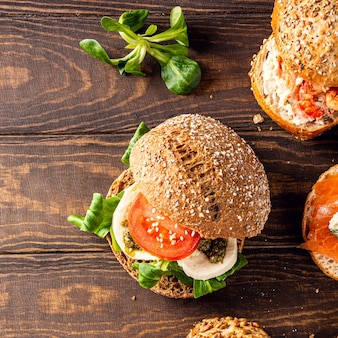 Overhead shoot with assorted sandwiches on wooden surface. healthy food concept with copy space. top view