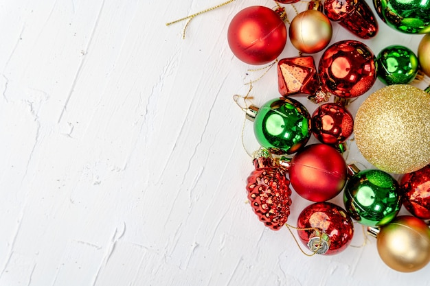 Overhead shot of colorful christmas ornaments with space for your text