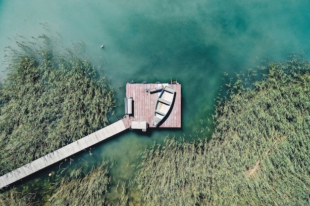 Overhead shot of a little dock at the coast with parked fishing boats
