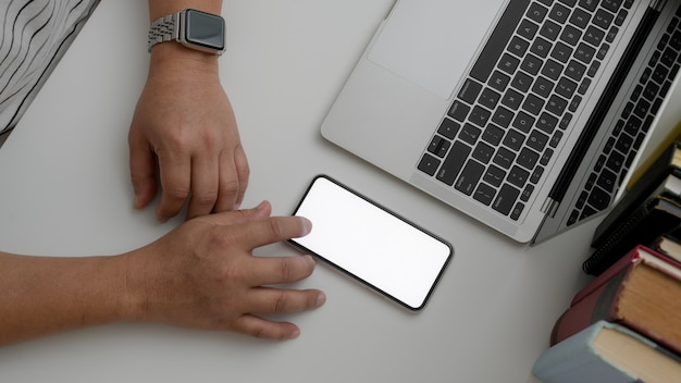 Overhead shot of male using blank screen smartphone