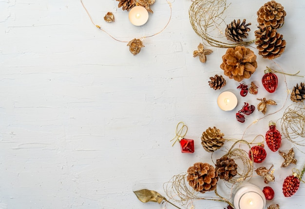 Overhead shot of a rustic colorful christmas decors on white wooden table with space for your text