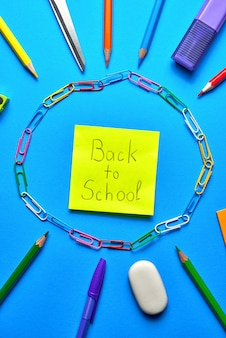 Overhead shot of school supplies on vibrant blue