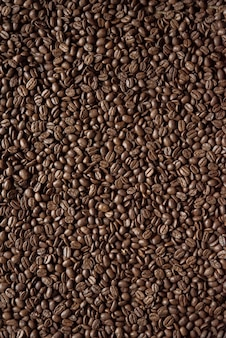 Overhead vertical shot of coffee beans great for background or a blog