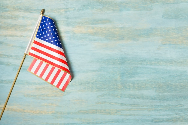 An overhead view of american flag on blue textured background