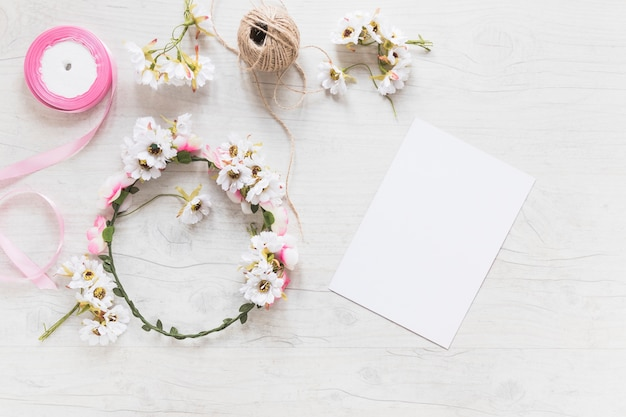 An overhead view of blank white paper with flower wreath