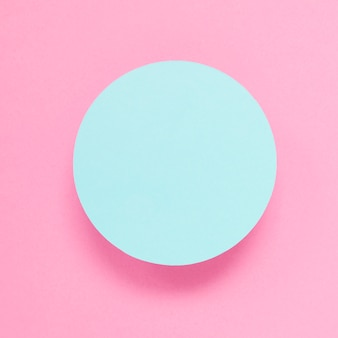 An overhead view of blue frame against pink background