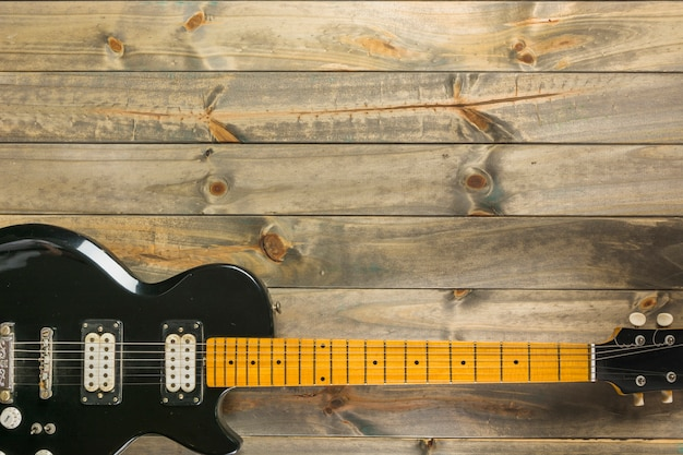 An overhead view of classic electric guitar on wooden table