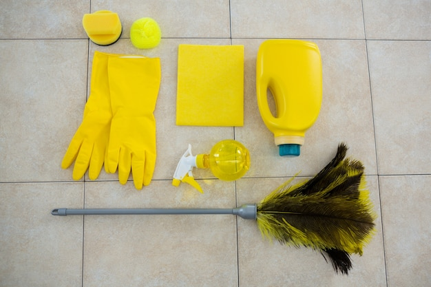 Overhead view of cleaning products and duster