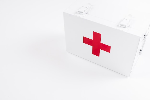Overhead view of closed first aid kit on white background