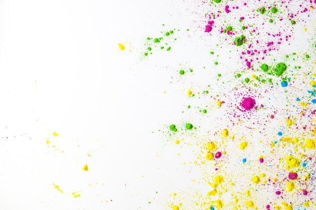 An overhead view of colorful holi power on white background