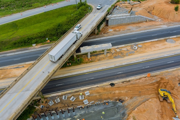 Overhead view of under construction works in highways of a bridge over a 85 interchange freeway