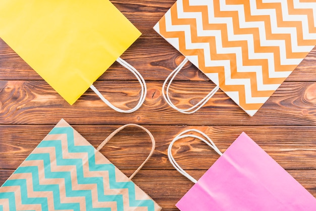 Overhead view of decorative paper bag on wooden table