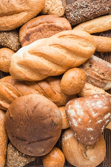 Overhead view of delicious baked breads with various shape