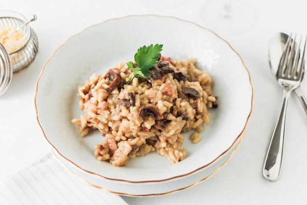 An overhead view of delicious mushroom risotto in white plate