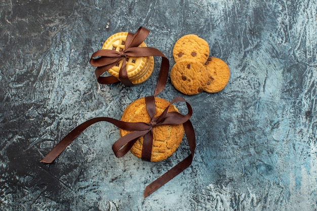 Overhead view of delicious stacked homemade cookies on ice background with free space