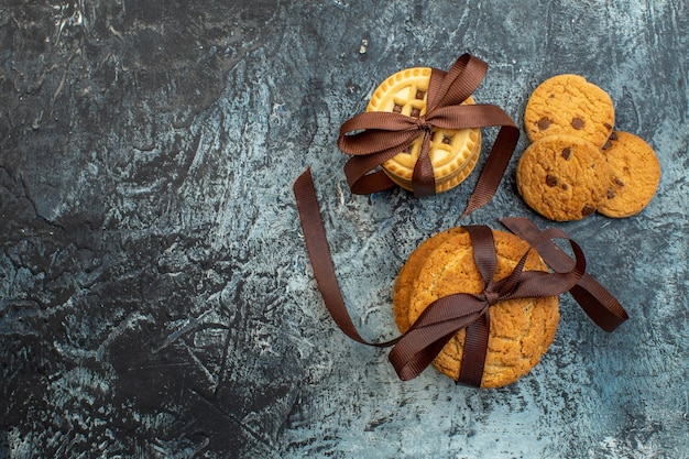 Overhead view of delicious stacked homemade cookies on the left side on ice background with free space