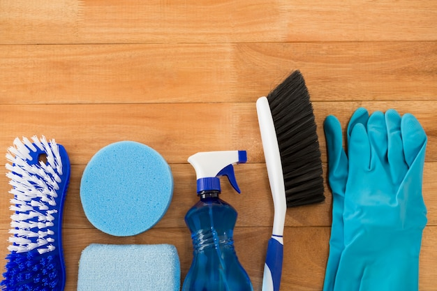 Overhead view of different cleaning equipment on table