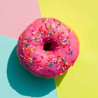 An overhead view of donut against colorful background