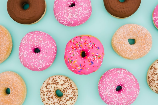 An overhead view of donuts on blue background