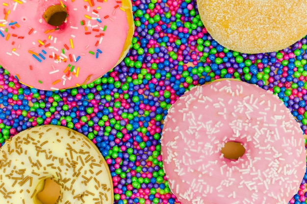 An overhead view of donuts on the sprinkle balls