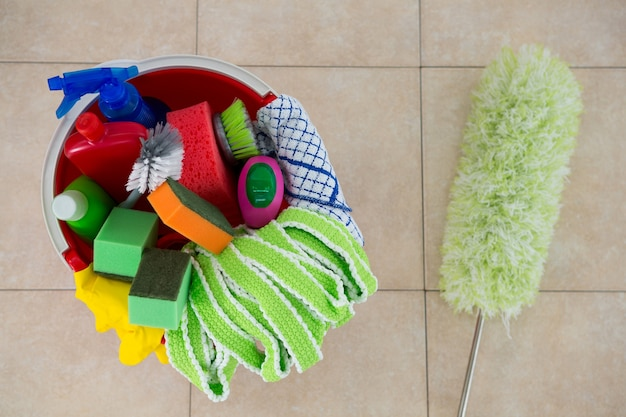 Overhead view of duster by various cleaning products in bucket