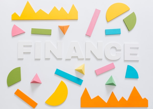 Overhead view of finance word with colorful graph and geometric shape