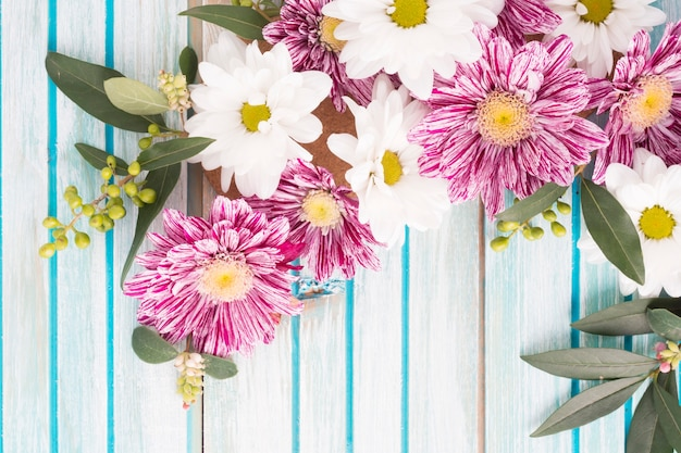 Overhead view of flowers decoration on wooden background