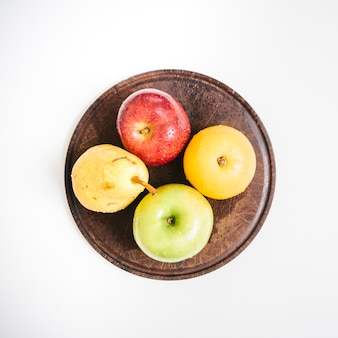 Overhead view of fresh fruits on plate